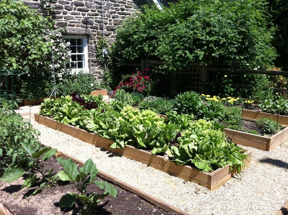 Potager Garden for a Traditional Landscape with a Stone Exterior and Vegetable Garden by Burke Brothers Landscape Design/build