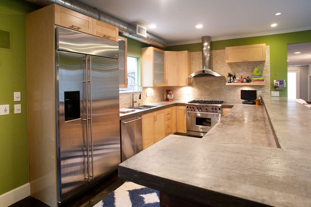 Poured Concrete Countertops for a Modern Kitchen with a Maple Cabinets and Vanderbilt by Modern Craft Construction, Llc