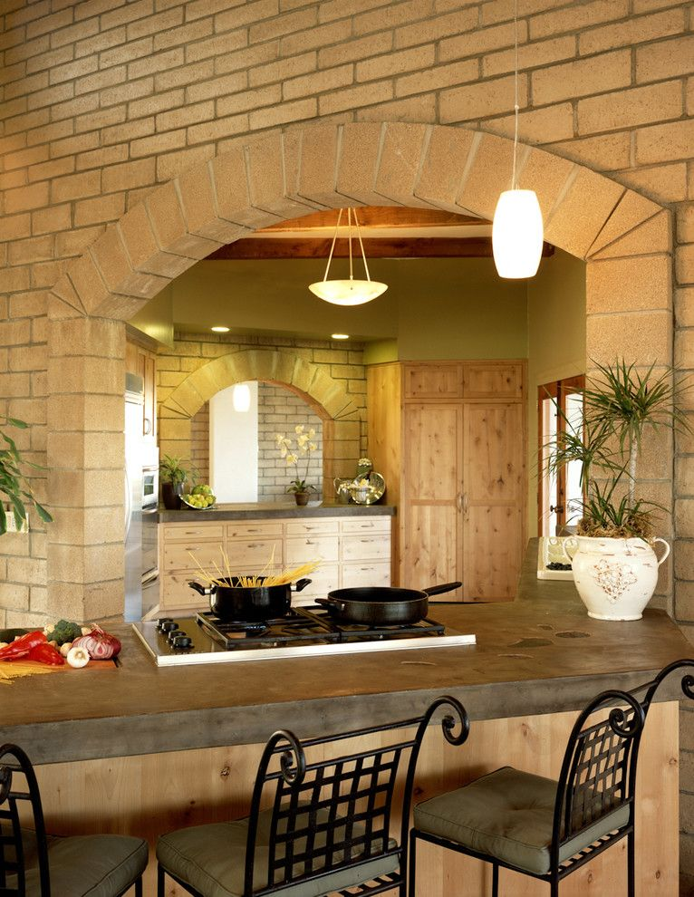 Poured Concrete Countertops for a Rustic Kitchen with a Arched Doorway and Blue House by Silva Studios Architecture