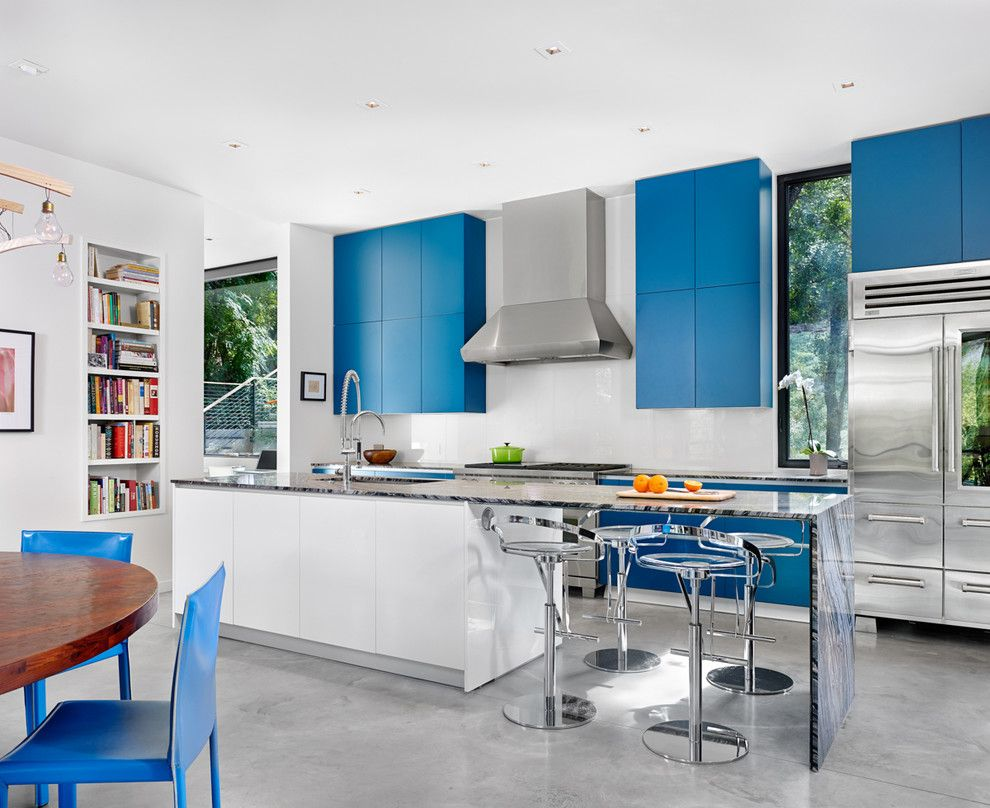 Precision Countertops for a Contemporary Kitchen with a Gray Floor and STRATFORD CREEK RESIDENCE by Matt Garcia Design