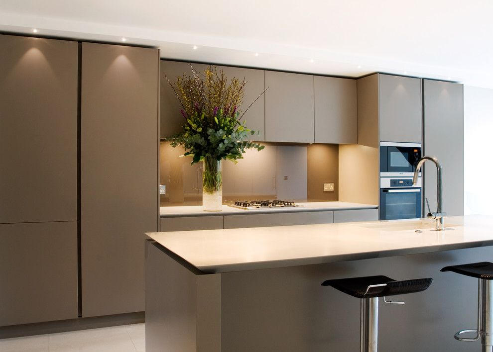 Precision Countertops for a Contemporary Kitchen with a Kitchen Island and Open Plan Handleless Kitchen by Neil Norton Design