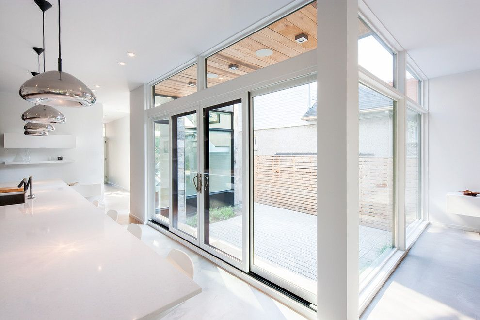Precision Countertops for a Contemporary Kitchen with a Mercury Pendants and Marvin Windows and Doors by Marvin Windows and Doors