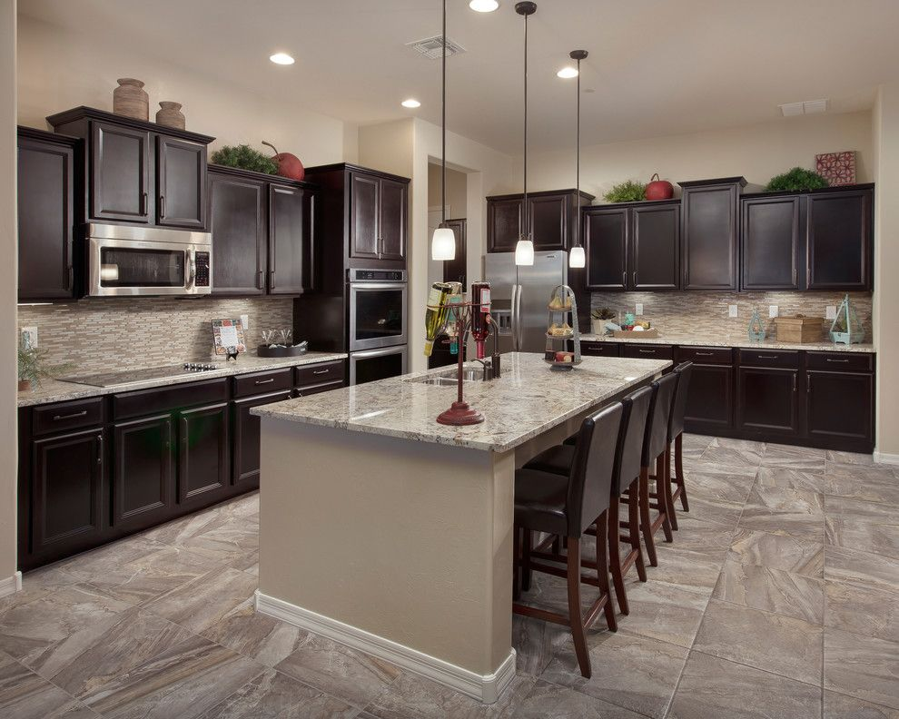 Precision Countertops for a Traditional Kitchen with a Leather Bar Stools and the Sabine Plan at Sky Ranch | Tucson, Az by Meritage Homes