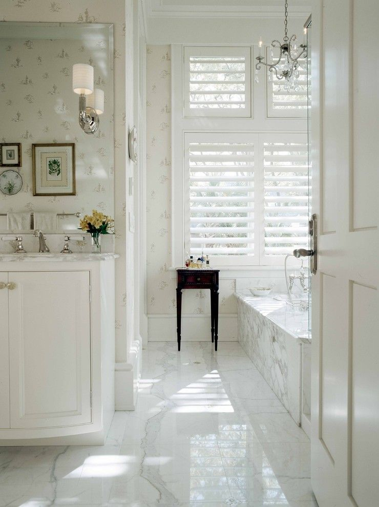 Preppy Wallpaper for a Traditional Bathroom with a Soaking Tub and Wetmore by Frederick + Frederick Architects