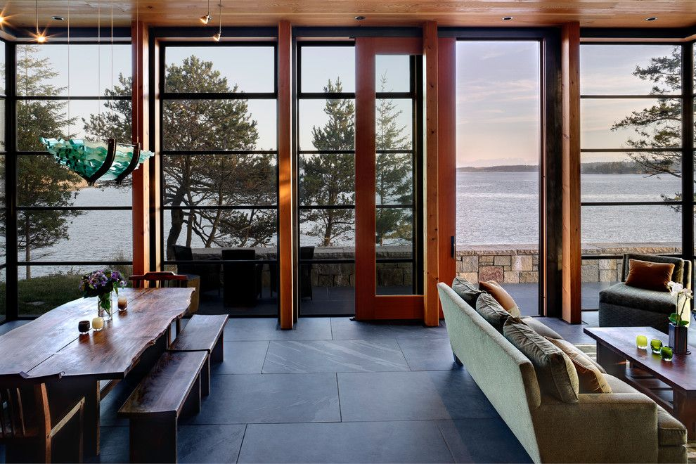 Pro Source Flooring for a Rustic Living Room with a Glass Pavilion and North Bay Residence by Prentiss Architects