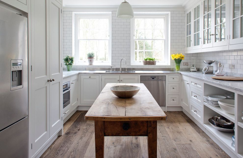 Pro Source Flooring for a Traditional Kitchen with a Wood Floor and the Pantry by Stephen Graver Ltd