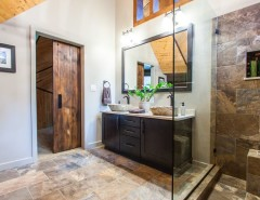 Probuild for a Rustic Bathroom with a Wood Ceiling and Bathroom: D.K. Residence by PRO-Builders