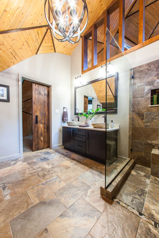 Probuild for a Rustic Bathroom with a Wood Ceiling and Bathroom: D.k. Residence by Pro Builders