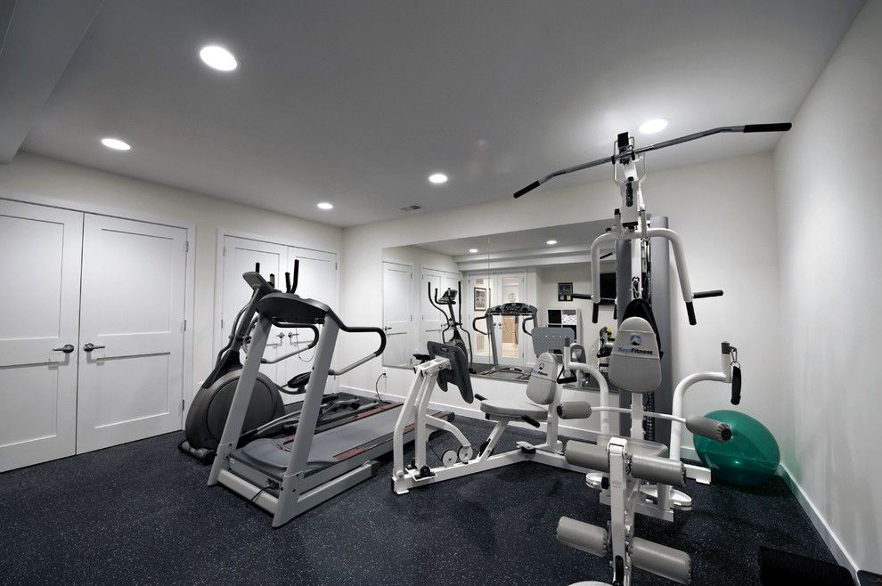 Prosource Flooring for a Contemporary Home Gym with a Moss Home Services and Award Winning Basement by Moss Building and Design