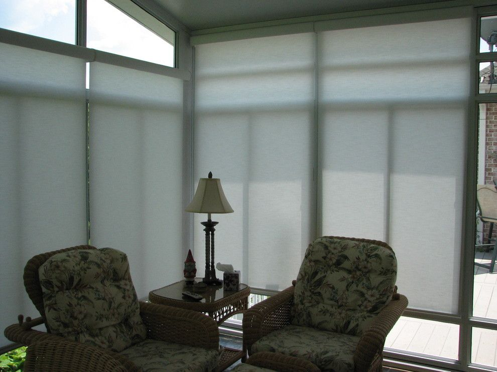 Qmotion for a Eclectic Sunroom with a Qmotion and Sunroom Motorized Solar Shades by Lightstyle Solutions