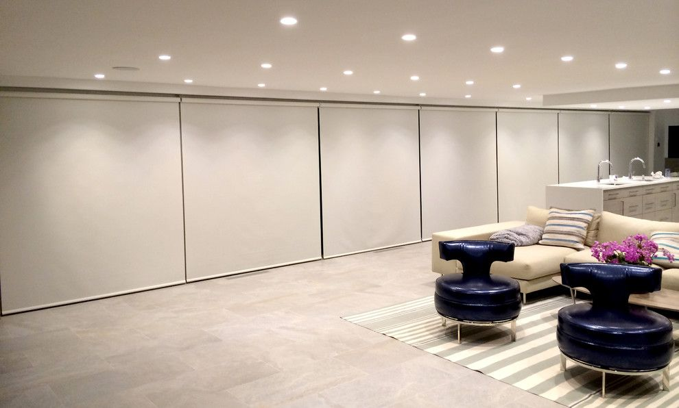 Qmotion for a Modern Family Room with a Striped Rug and Motorized Screen Shades by v Lonne Custom Window Treatments Ny