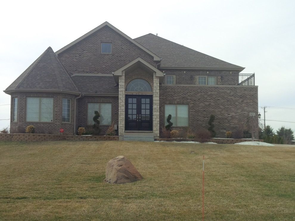 Quaker Windows for a Modern Exterior with a Roofing Gutters and Brand New Home Frankfort, Il by Chicagoland Builders
