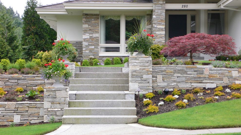 Quality Stone Veneer for a Contemporary Exterior with a Potted Plants and Cultured Stone Wall and Facing by Landscape East & West