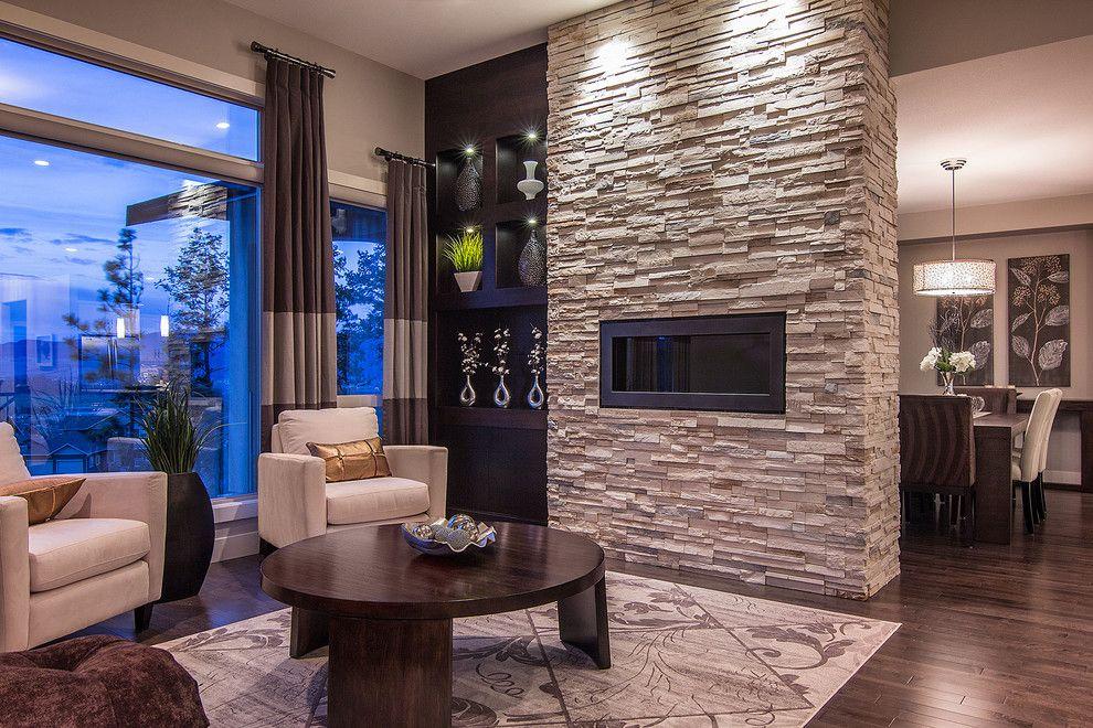 Quality Stone Veneer for a Contemporary Living Room with a White Arm Chairs and Summit at Selkirk by Dilworth Homes