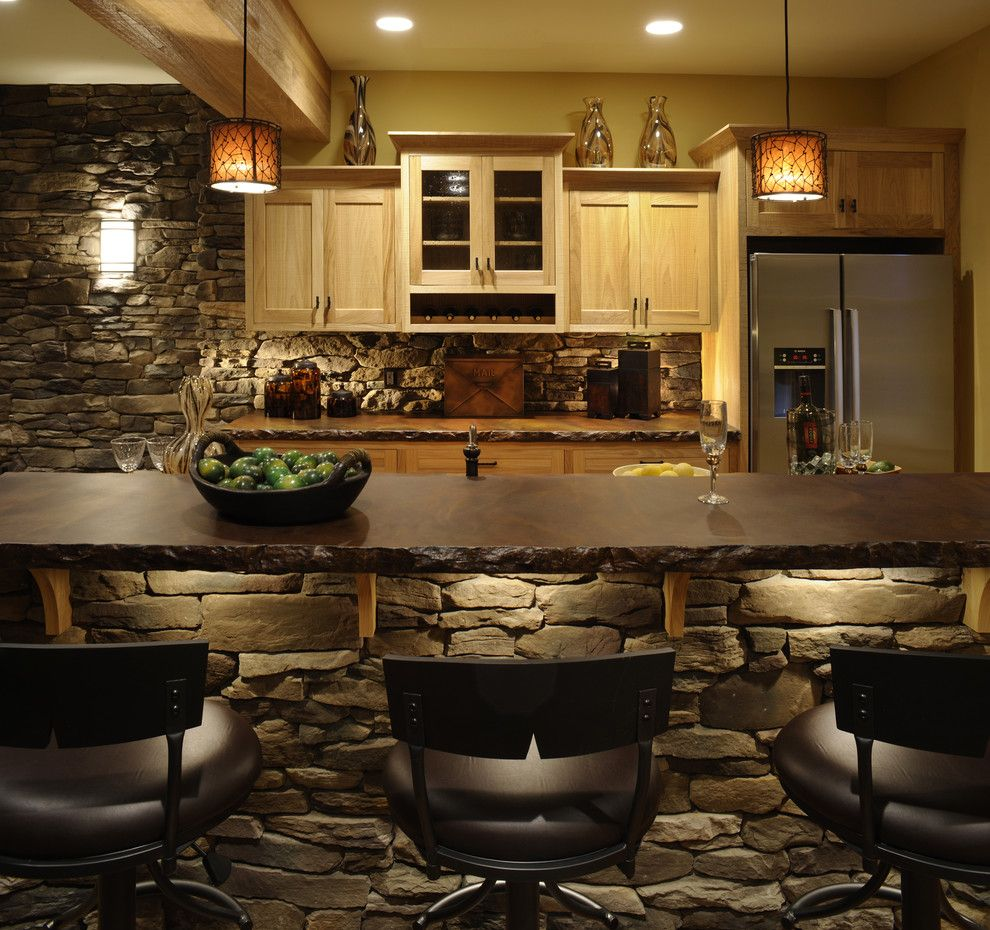 Quality Stone Veneer for a Rustic Kitchen with a Pendant Lighting and Ackerly Park ~ New Albany, Ohio by Weaver Custom Homes