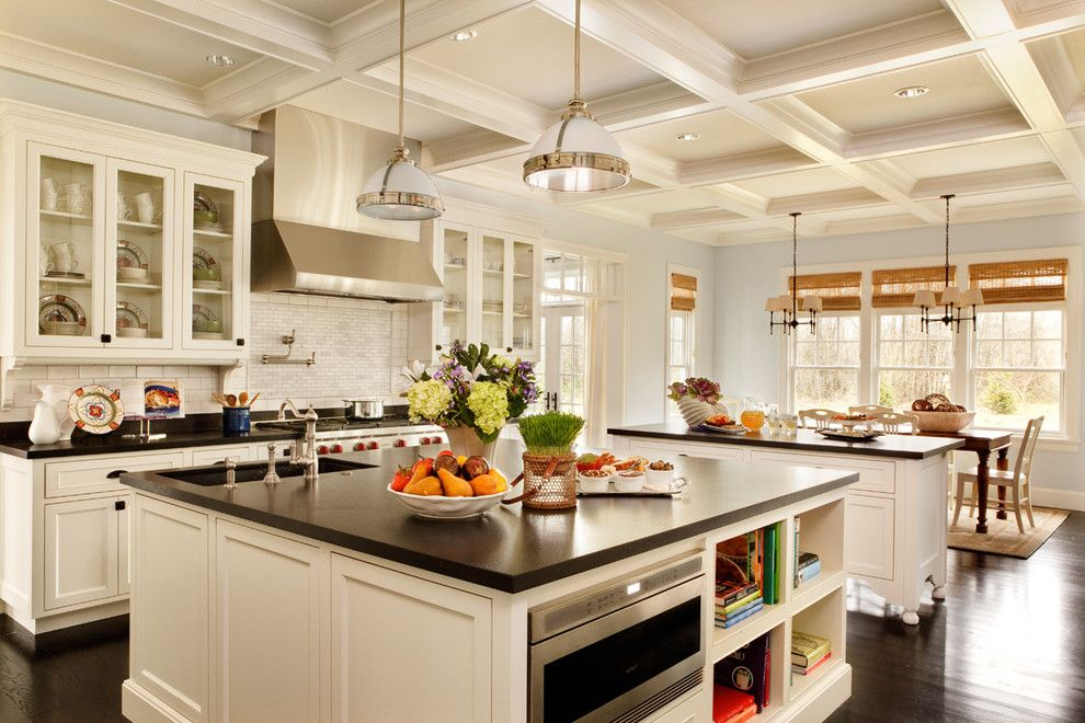 Quartz vs Granite Countertops for a Traditional Kitchen with a Backsplash and Expansive Kitchen by Garrison Hullinger Interior Design Inc.