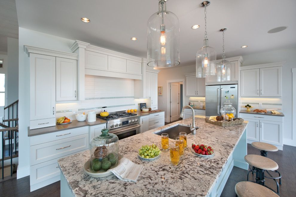 Quartz vs Granite Countertops for a Traditional Kitchen with a Bell Glass Pendants and Skylands Show Home by Sticks and Stones Design Group Inc.