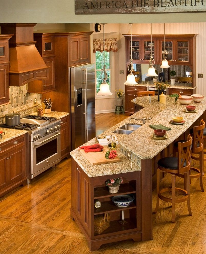 Quartz vs Granite Countertops for a Traditional Kitchen with a Large Island Granite Counter Tops Pass Thru Wall Hutch Hardw and Total Kitchen Renovation by KITCHEN and BATH WORLD, INC