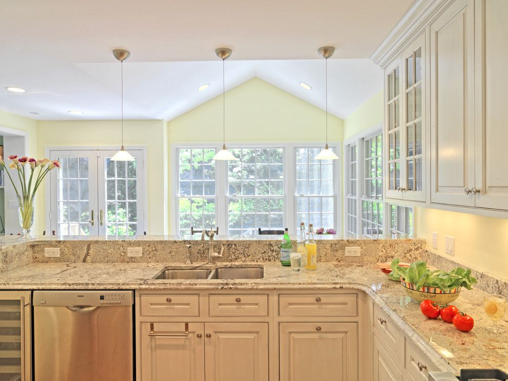Quartz vs Granite Countertops for a Traditional Kitchen with a Slab Countertops and Case Design/remodeling, Inc. by Case Design/remodeling, Inc.