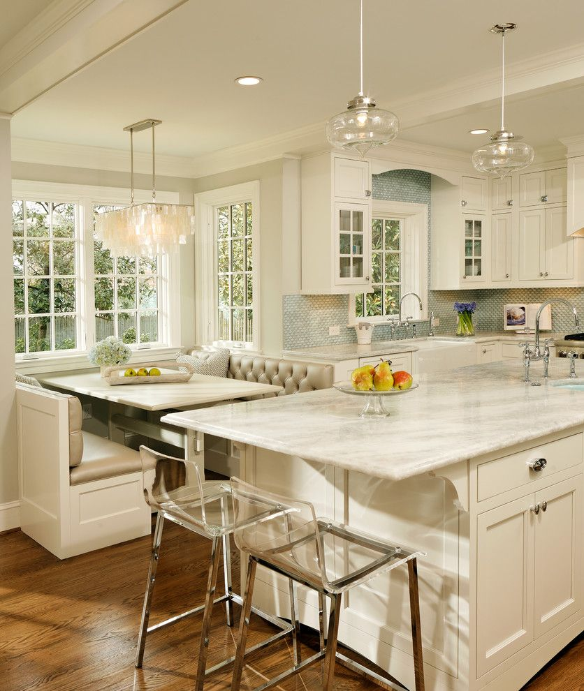 Quartzite vs Granite for a Traditional Kitchen with a White Kitchen and Green with Envy: Leed Certified Whole House Renovation by Harry Braswell Inc.