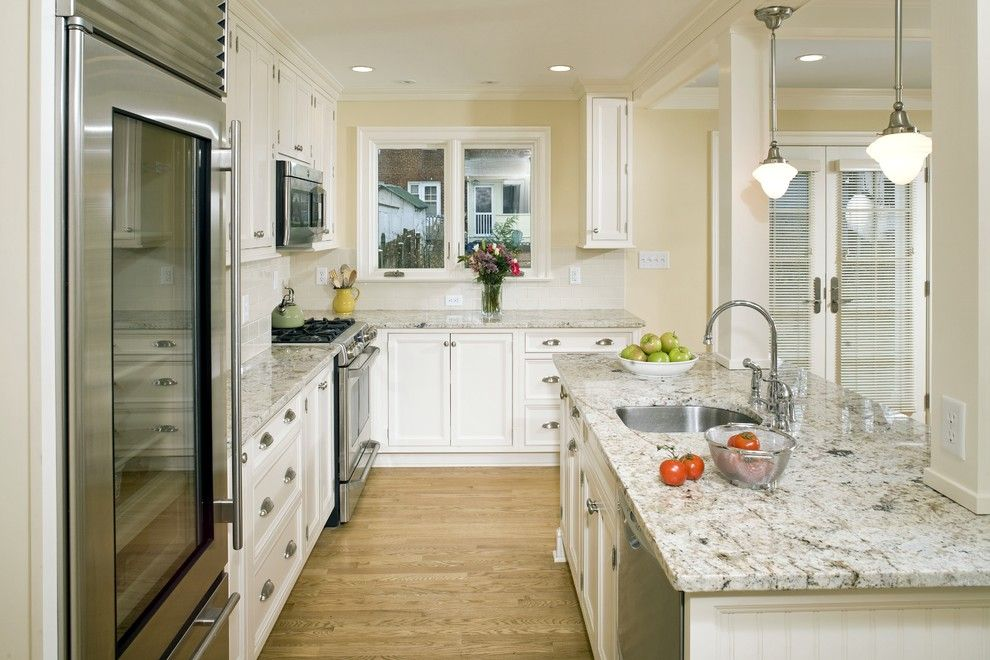 Quartzite vs Granite for a Traditional Kitchen with a Wood Floor and Alexandria Timeless Kitchen Addition by Erin Hoopes