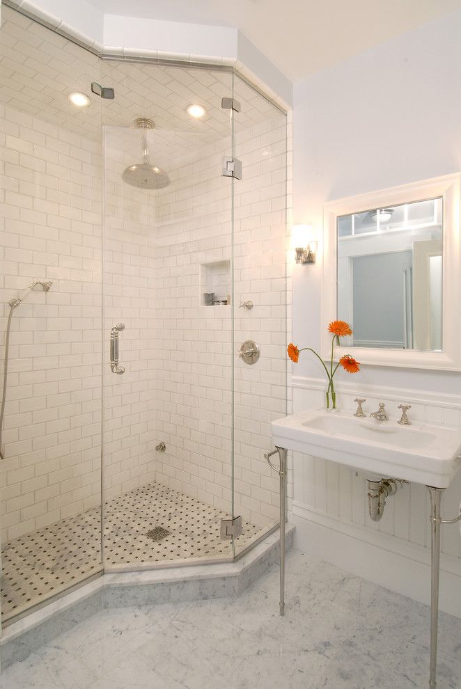 Radiant Plumbing for a Traditional Bathroom with a Basketweave Tile and Greek Revival Bath with Transom Windows by Charlie Allen Renovations, Inc.