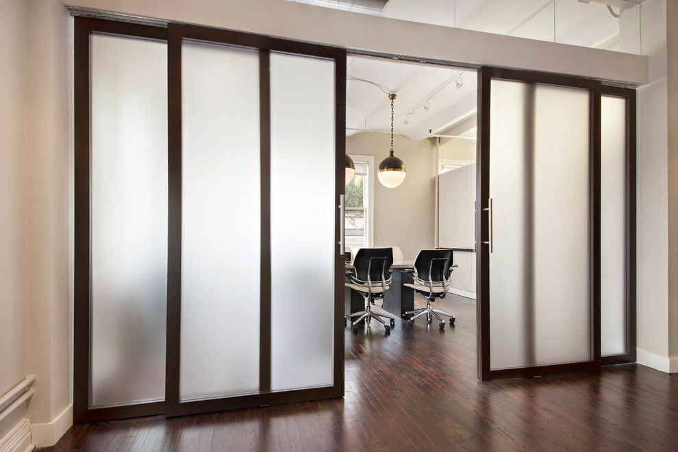 Raydoor for a  Spaces with a Sliding Barn Door and Wimberly Interiors by Raydoor