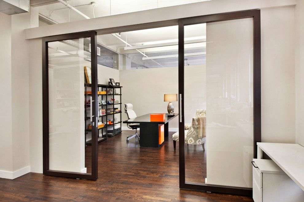 Raydoor for a  Spaces with a Sliding Barn Doors and Wimberly Interiors by Raydoor
