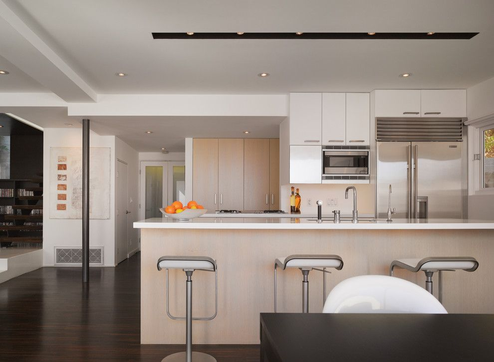 Recessed Lighting Layout for a Modern Kitchen with a Wood Cabinets and Griffin Enright Architects: Hollywood Hills Residence by Griffin Enright Architects