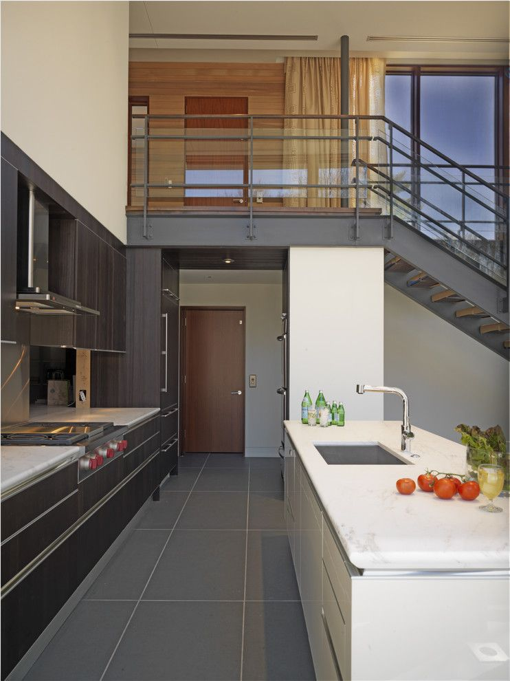 Rectified Tile for a Contemporary Kitchen with a Wood Paneling and Woodvalley House   Kitchen by Ziger/snead Architects