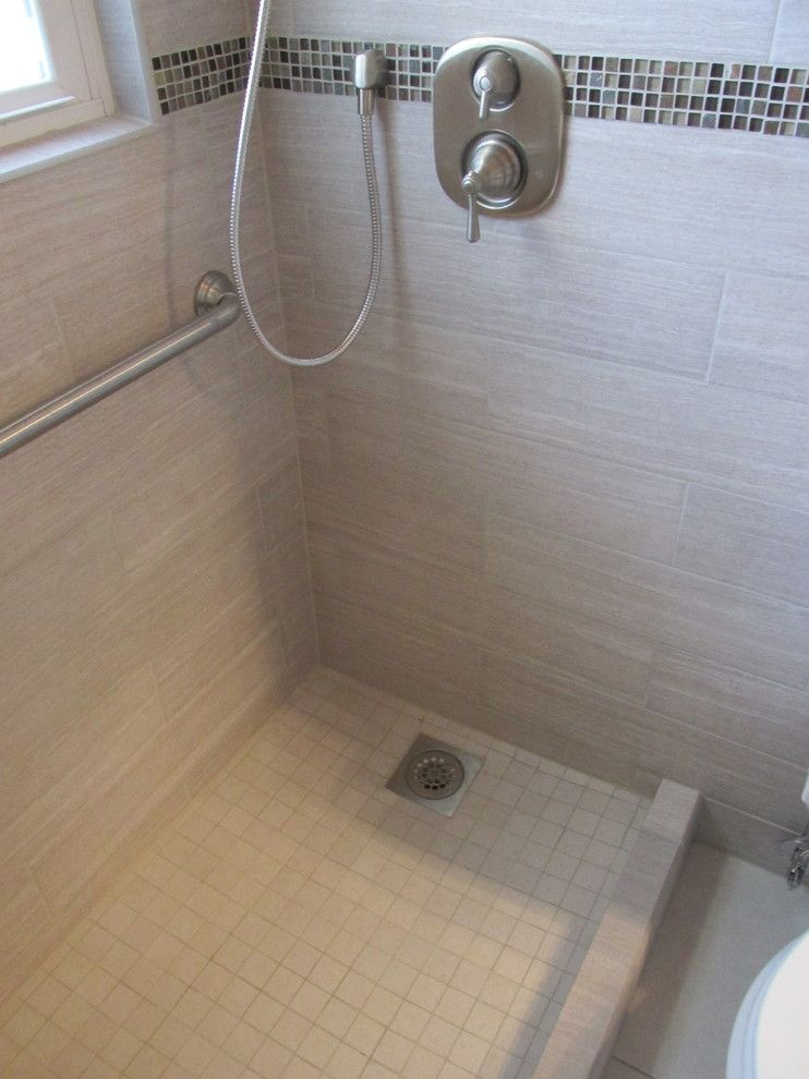Redi Floors for a Contemporary Spaces with a Large Format Floor Tile and Small Bathroom Remodel & Tub Replacement by Contemplative Construction, L.l.c.