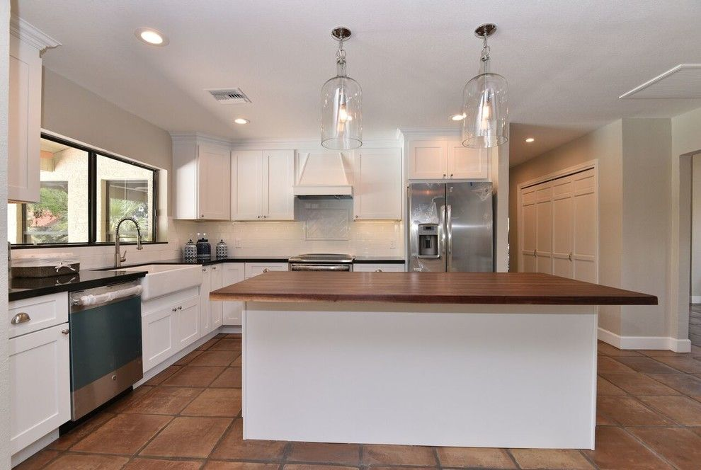 Reef Builders for a Traditional Spaces with a Butcher Block Countertop and Poinsetta   Complete Remodel by Reef Builders Llc