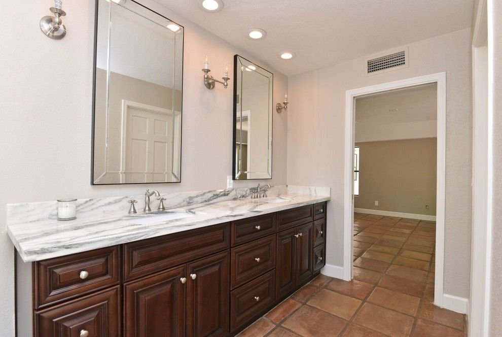 Reef Builders for a Traditional Spaces with a Vintage Bathroom Sconces and Poinsetta   Complete Remodel by Reef Builders Llc