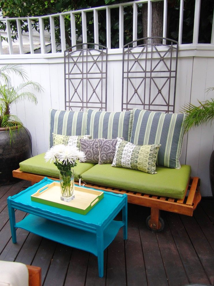 Refinished Furniture for a Eclectic Deck with a Potted Plants and Cococozy in the Hollywood Hills by Cococozy
