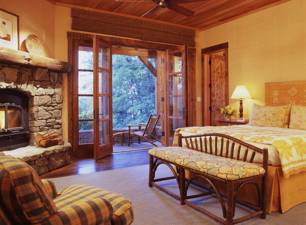 Regency Fireplaces for a Rustic Bedroom with a Dark Floor and Family Ranch by Tucker & Marks