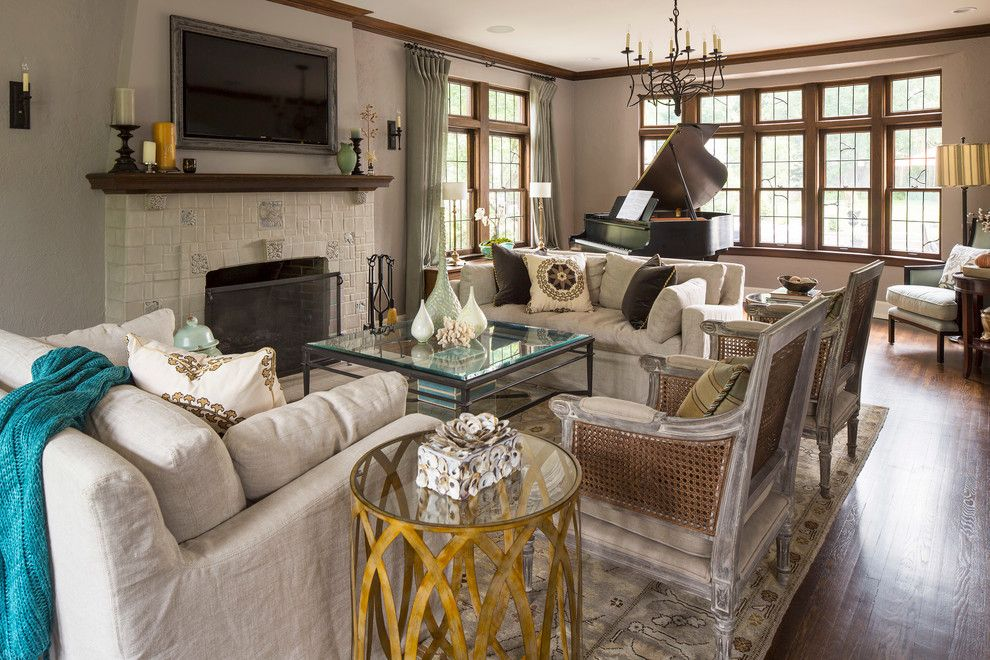Regency Fireplaces for a Traditional Living Room with a Glass Top Coffee Table and Lake Harriet Tudor by Renae Keller Interior Design, Inc.