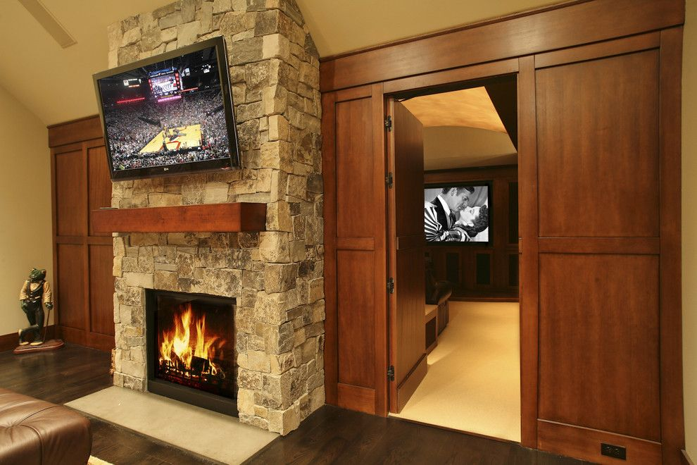 Regency Fireplaces for a Traditional Living Room with a Hardwood Flooring and Gentleman's Pub by Garrison Hullinger Interior Design Inc.
