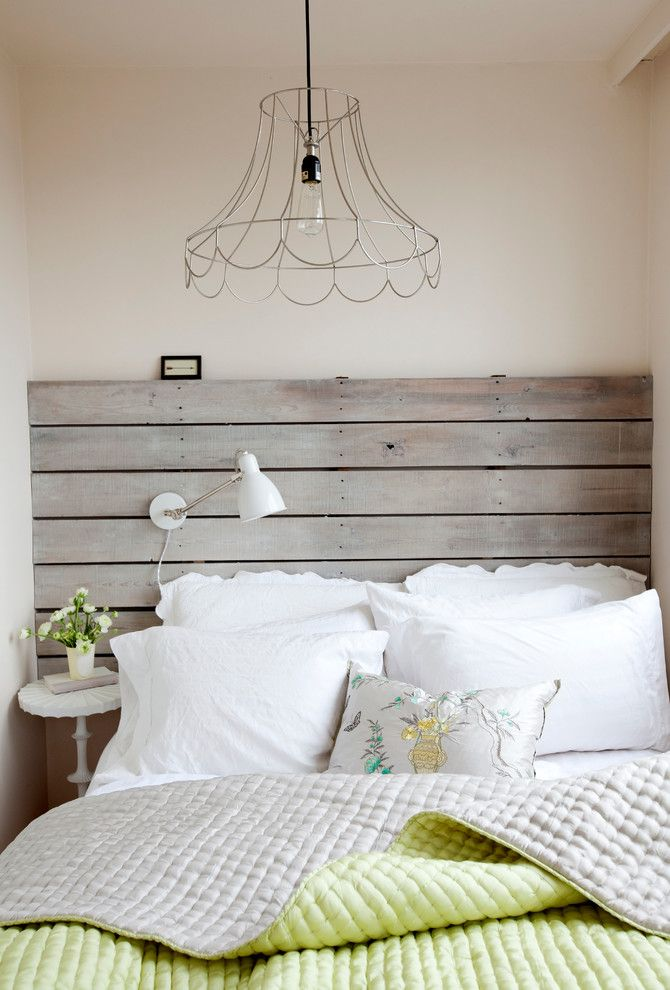 Repurposed Pallets for a Shabby-Chic Style Bedroom with a Repurposed Wood Headboard and West End Studio by the Cross Interior Design