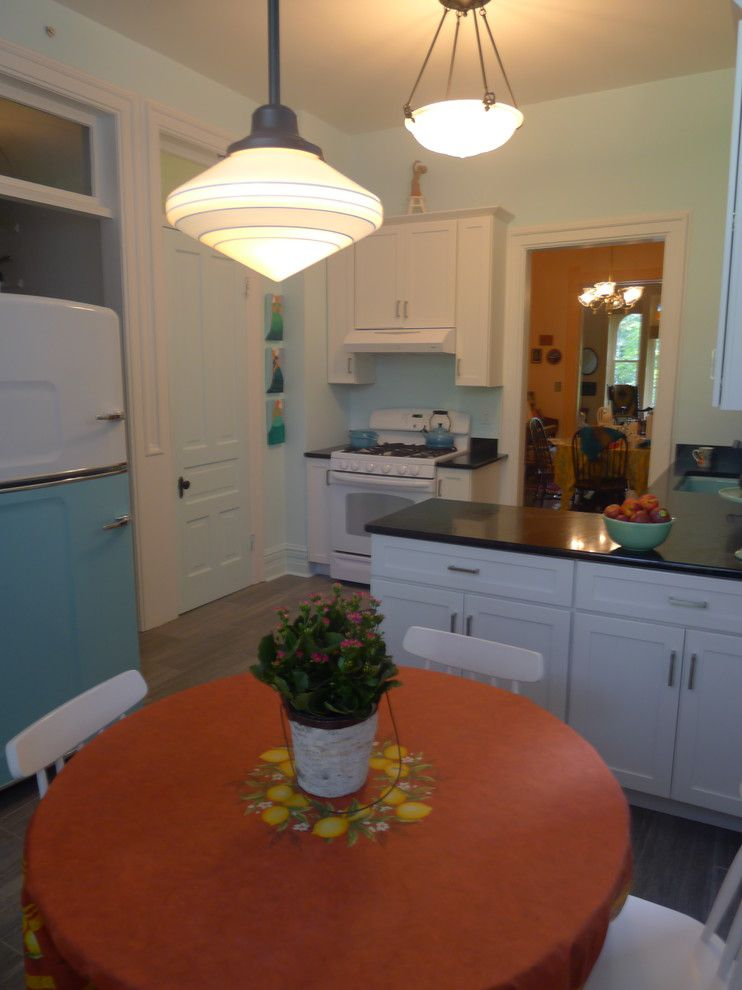 Retro Renovation for a Eclectic Kitchen with a Bold Colors and Retro Kitchen Renovation in River North by Sarah Babbitt