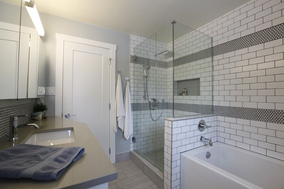 Retro Renovation for a Midcentury Bathroom with a Round Penny Tile and Retro Modern Renovation by Flawless Interiors Inc.