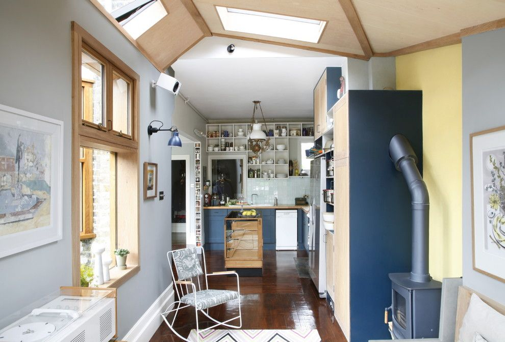 Reupholstered for a Eclectic Kitchen with a Kitchen Storage and Victorian House S. East London by Alison Hammond Photography