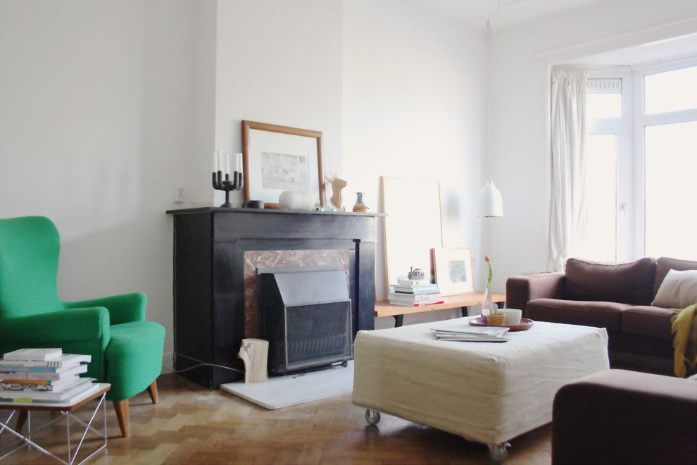 Reupholstered for a Eclectic Living Room with a Fireplace and the Home of Edwin by Holly Marder