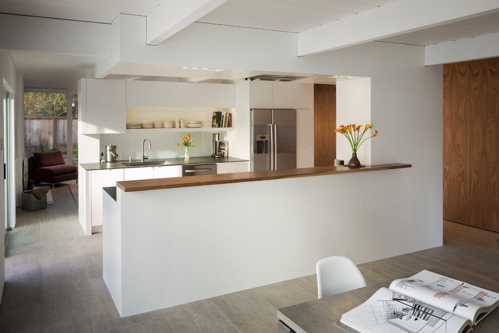 Richlite for a Midcentury Kitchen with a Dining Table and Eichler in Marinwood by Building Lab, Inc.