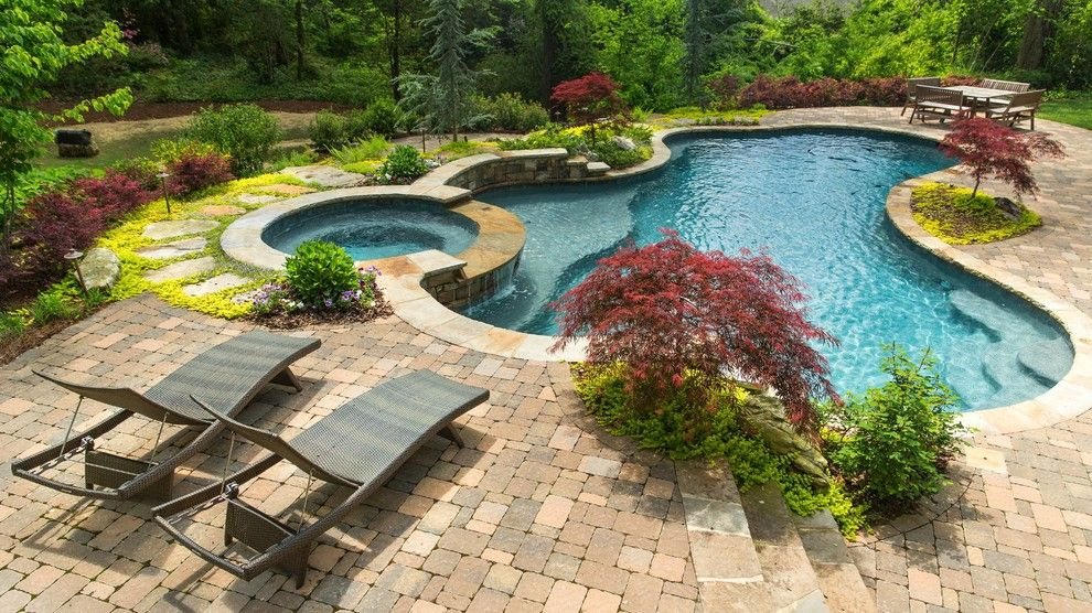 Rising Sun Pools for a Traditional Pool with a Round Spa and Pools by Landscape Studio