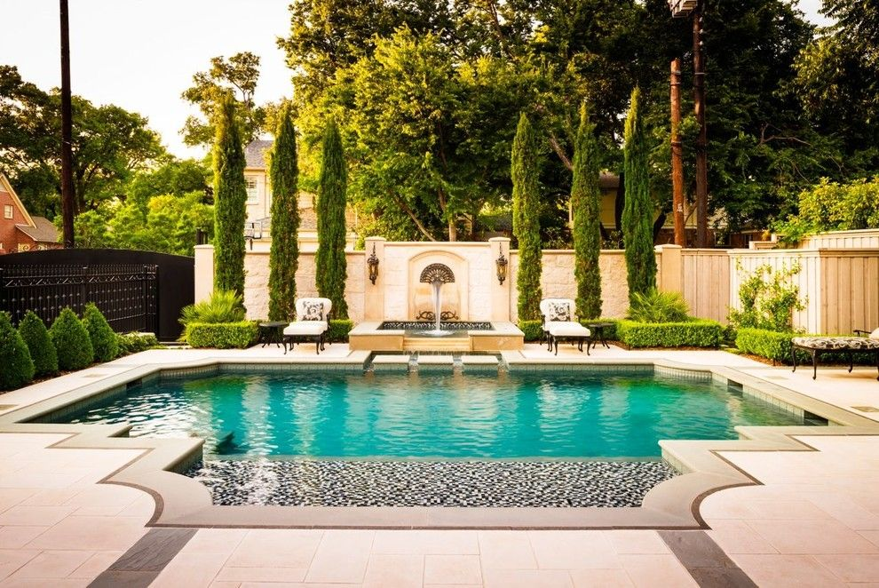 Rising Sun Pools for a Traditional Pool with a Wet Deck and Elegant by Pool Environments, Inc.