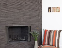 Roca Tile for a Midcentury Dining Room with a Dark Tile and Rustic Modern Fireplace by Regan Baker Design
