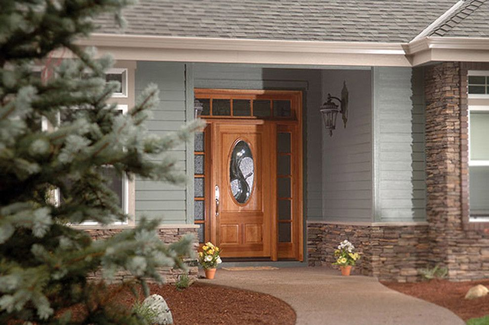 Rogue Valley Doors for a Craftsman Exterior with a Arched Entry and Doors by Rogue Valley Door