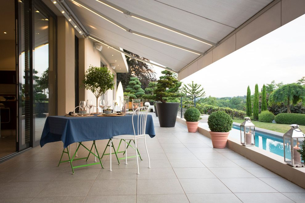 Rogue Valley Doors for a Modern Patio with a Sliding Glass Door and Somfy by Somfy