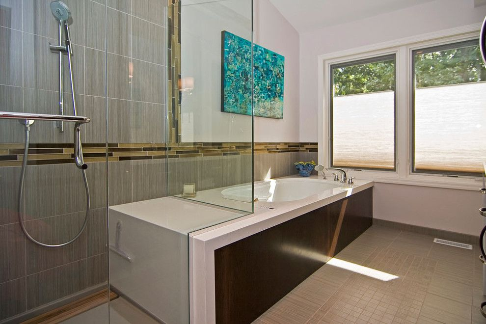 Roman Tub for a Modern Bathroom with a Floor Tile Design and Modern Master Bath by Mosby Building Arts