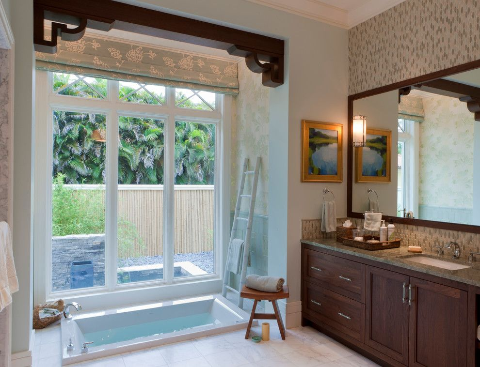 Roman Tub for a Transitional Bathroom with a Wood Framed Mirror and Tranquil Eclectic Residence by Deakins Design Group
